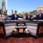 Chicago, IL - September 25, 2021 - Solidier Field: Desmond Howard, Rece Davis, Lee Corso and Kirk Herbstreit holding hands on the set of College GameDay Built by the Home Depot. (Photo by Phil Ellsworth / ESPN Images)